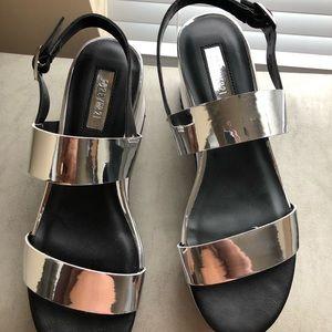 Platinum chrome platform shoes